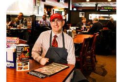 Brann's steakhouse, man with menu