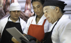 Butchers analyzing meat
