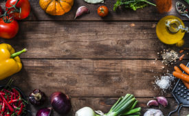 rustic wooden plank with fresh organic vegetables
