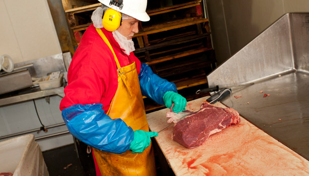 man slicing meat