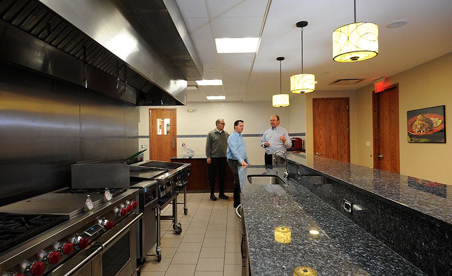 Gerald Lessard, vice president and COO of West Liberty Foods, shows off the culinary kitchen purchased along with the Bolingbrook facility