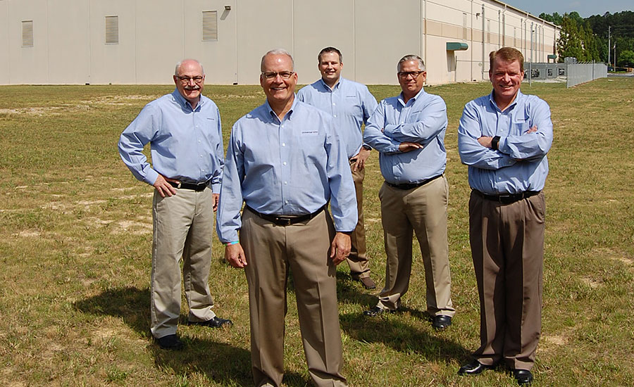 The executive team of Universal Pasteurization Co. outside the company's Villa Rica, Ga., processing facility