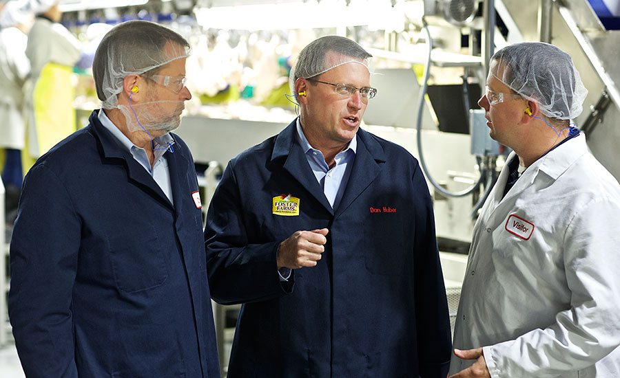 Chris Carter and Dan Huber of Foster Farms discuss the renovations at Foster Farms' Livingston, Calif., processing facility