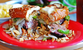 City Barbeque's More Cowbell sandwich includes beef brisket, topped with peppers, smoked provolone, onions and creamy horseradish sauce piled high on Texas toast