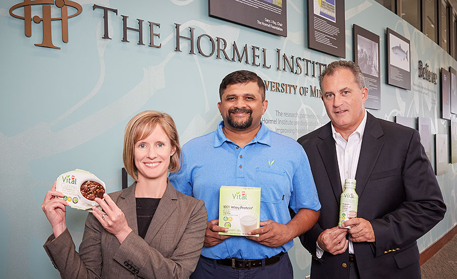 Melissa Bonorden, Chet Rao and Don Kremin, of Hormel Foods, display several Hormel Vital Cuisine products