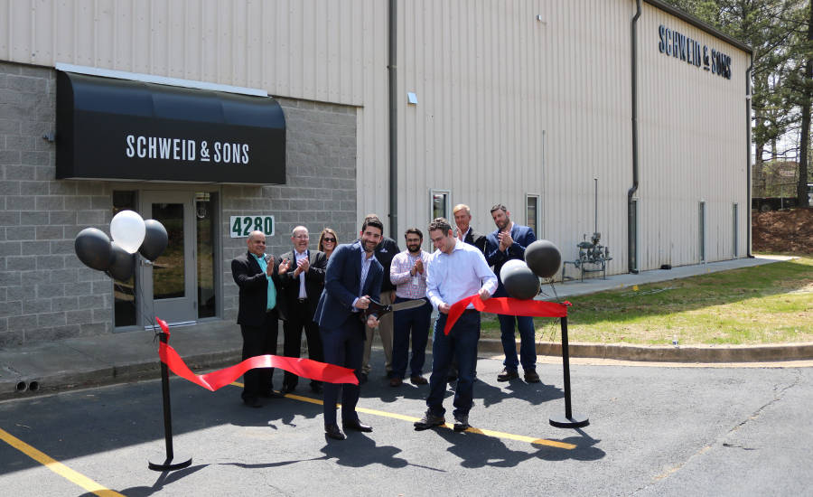 Jamie and Brad Schweid cut the ribbon to officially open the new Schweid & Sons facility in College Park, Ga.