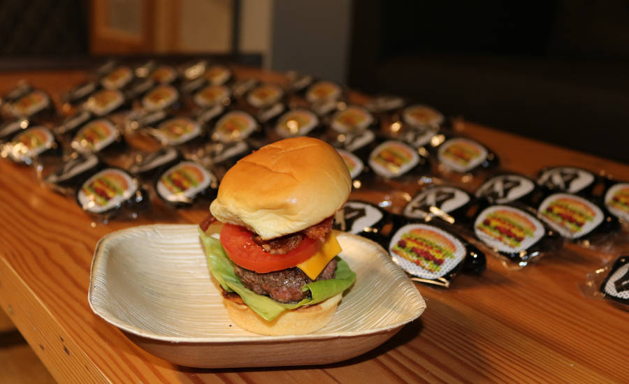 Gourmet burger sliders were served to all guests at the opening of Schweid & Sons' new facility