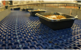 Conveyor with food packages