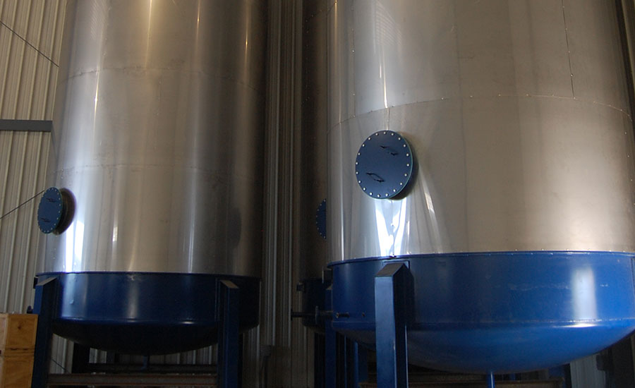 Large tanks, located inside Rantoul Foods' new rendering facility, that will hold finished rendered product