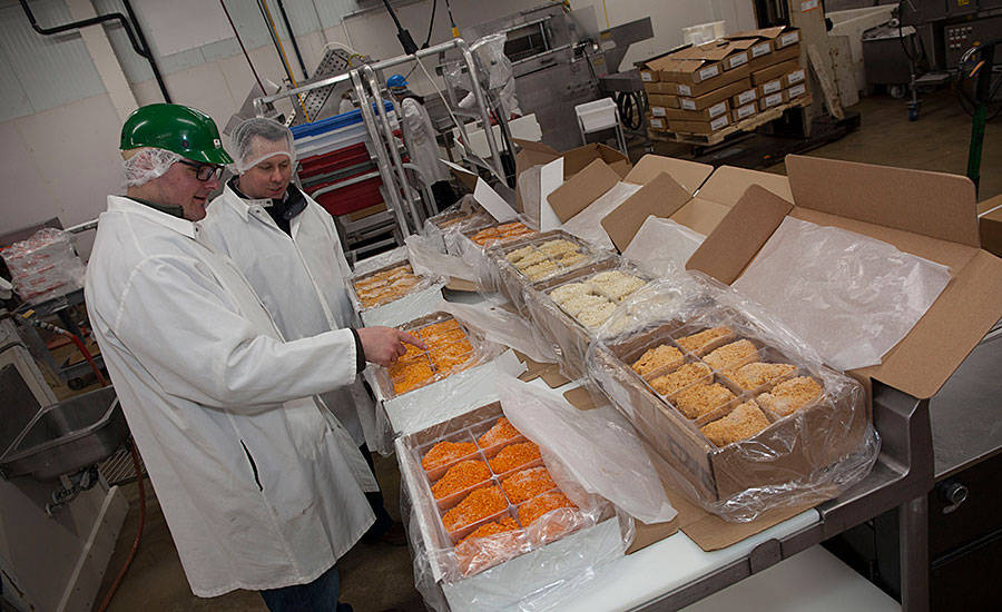 Jon Garberg and Andy Hanacek examine J&B Group breaded chicken products