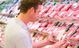 Retail Consumer Looks at Package of Beef