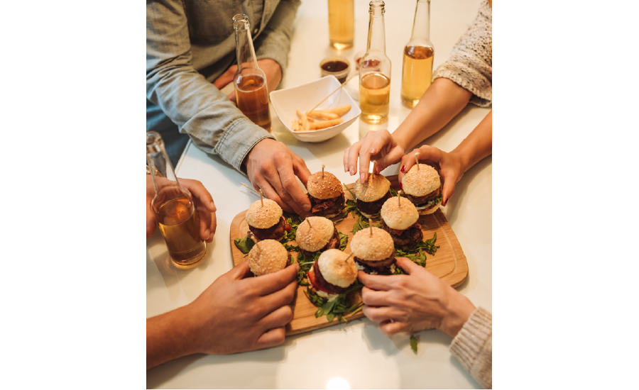 Hands Holding Hamburger Sliders