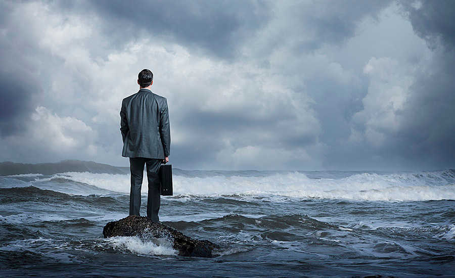 Business Man Standing on Rock in Water