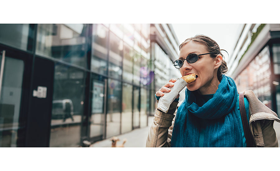 Woman Eating Burrito On the Go