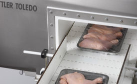 Packages of Chicken Going Through Metal Detection Equipment