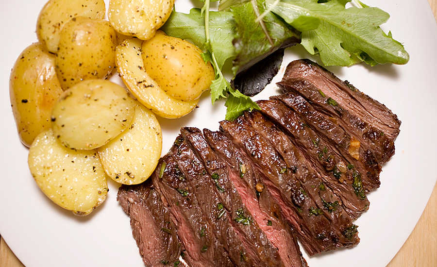 Beef Tenderloin, Potatoes, and Salad on Plate