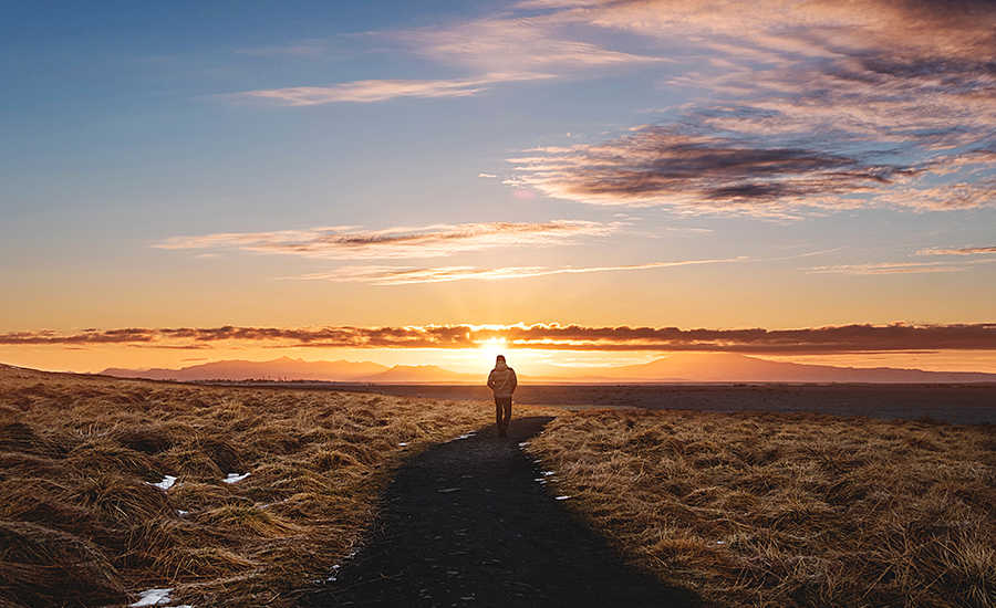 Person Hiking in the Sunset