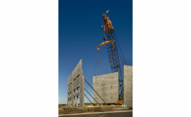 crane and concrete walls