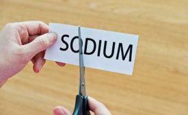 scissors cutting the word sodium in half