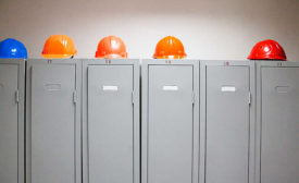 row of lockers with hard hats on top