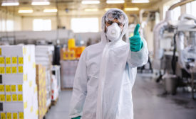 man in foodservice safety apparel giving thumbs up