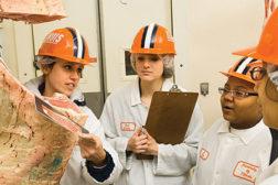 students examining carcass