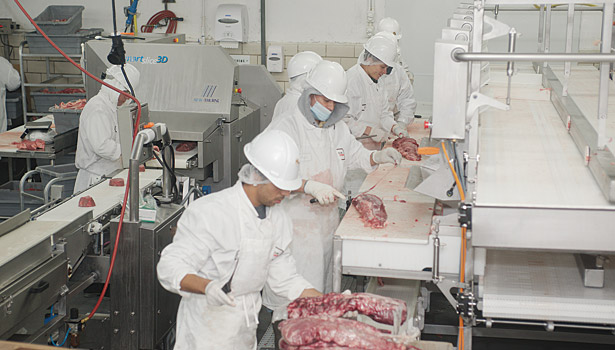 Lone Star employees, cutting meat