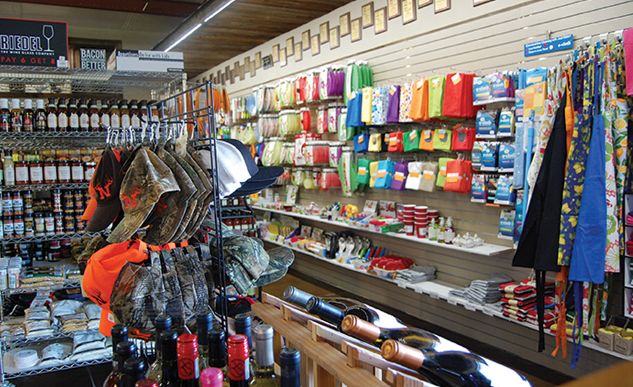 Wahoo Locker retail store features a display of Wahoo Locker meat products and cooking accessories