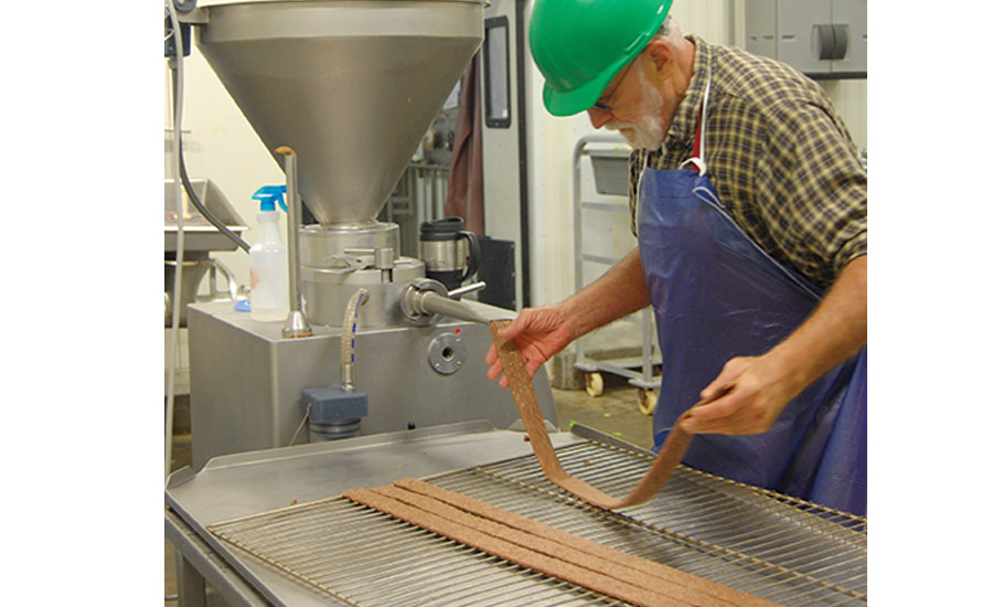 A Wahoo Locker worker prepares some bison jerky for a private-label business customer