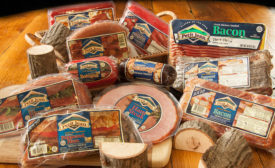 A variety of Petit Jean Meats products including ham, sausage, bacon, and bologna