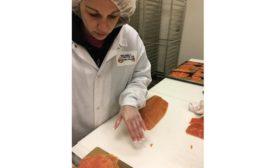 Shuckman's Employee Hand-Slices Fish