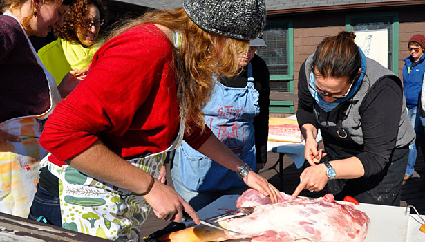 girls slicing meat