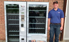 Joe Reams stands with RJ's Meats meat vending machine