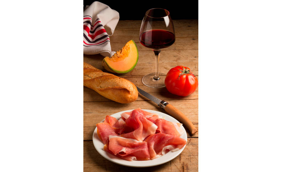 Bayonne Ham With Bread, Fruits, and Wine on Table