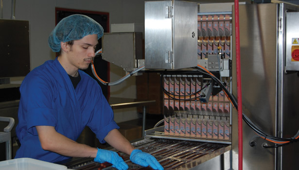Country Meats employee making snack sticks